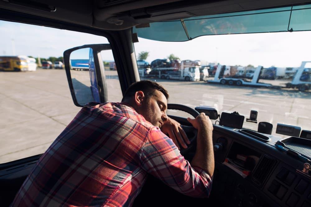 Truck drive asleep in truck