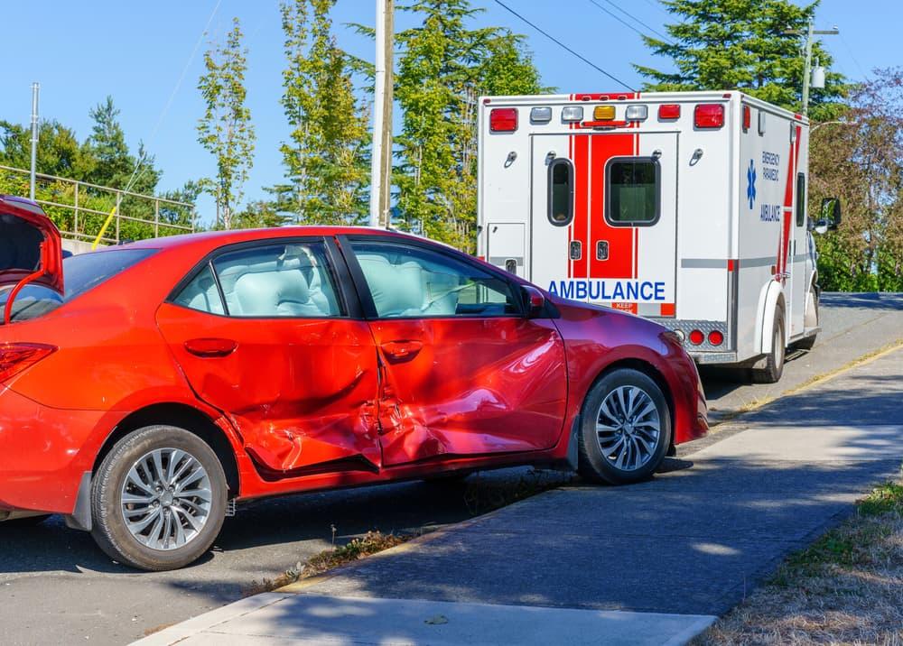 crashed car behind ambulance