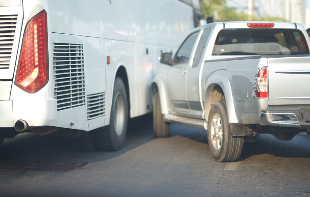 a crash between a pickup and a bus